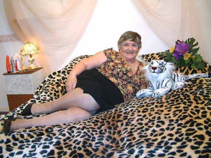 Fat granny naked on a tiger-skin blanket