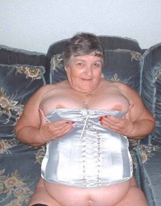 Busty granny in a tight basque