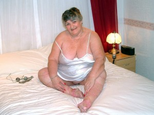 Fat mature in Silver Satin playing with herself