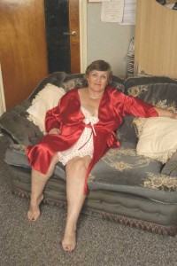 Grandma in red lingerie showing pink
