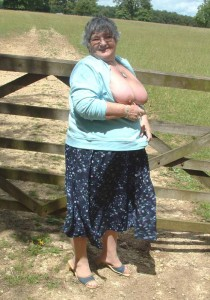 Granny in knickers on a country field