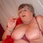 Granny smoking a cigar and showing her pussy