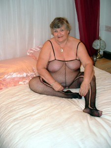Granny Libby toying in a body stocking