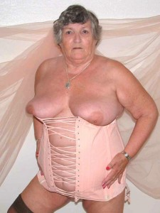Sassy granny in lace up corset & Black Stilettos