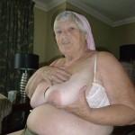 Old slut sucking her titties